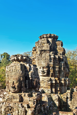 thom: Faces of ancient Bayon Temple At Angkor Wat, Siem Reap, Cambodia
