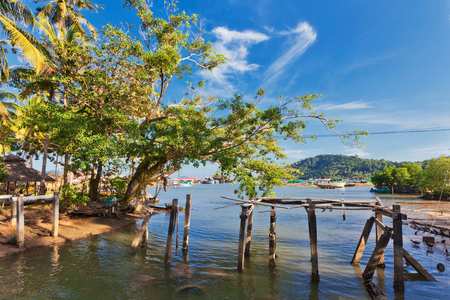 Broken wooden bridge near the village on the water. Thailand
