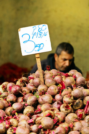 26: JERUSALEM, ISRAEL - DECEMBER 26, 2016:  beetroot is on the counter in the market of Mahane Yehuda in Jerusalem. More than 250 marketers sell fruits, vegetables, baked products, fish, meat and others