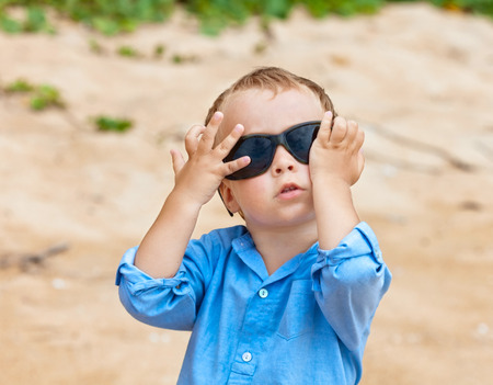 Portrait of cute 2,5 years old child with sunglasses Stock Photo