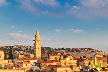 A view on rooftops of Old City of Jerusalem. Grey dome of Church of Our Lady of the Spasm (Armenian church) and golden Dome of the Rock. Stock Photo