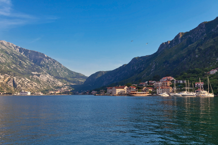 Yacht marina is located opposite the Old Town of Kotor, Montenegro 스톡 콘텐츠