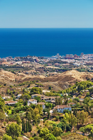 panoramic view of a mountain and Mijas, a small touristyc white-washed village at Malaga province. Andalusia, Spain
