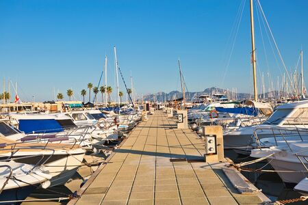 Boats docking in the marina in Port dAlcudia is a popular resort town and holiday destination on the northeast coast of Mallorca island. Spain