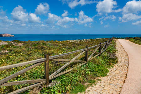 Beautiful view of coast of Sagres with hiking trail and wooden balustrade, Algarve, Portugal, Europe