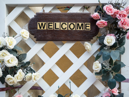 welcom: Wooden board have a label Welcom and flower Stock Photo