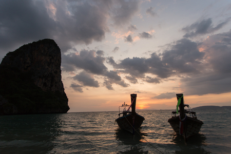 Traditional thai longtail boat at sunset on the Beach. Thailand, Krabi province