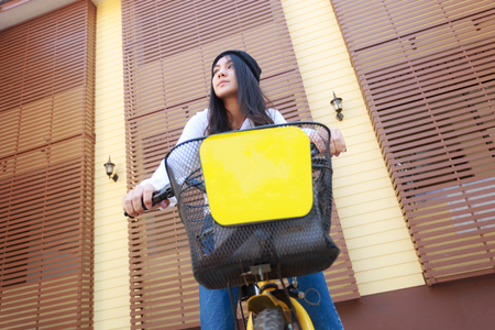 Asian woman sitting on the bicycle for travel.