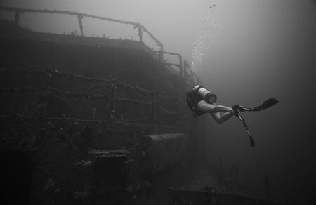 ship wreck: A diver alone approaching the largest artificial reef in the world