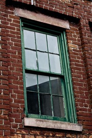 Green Window Frame in Brick Wall Reklamní fotografie