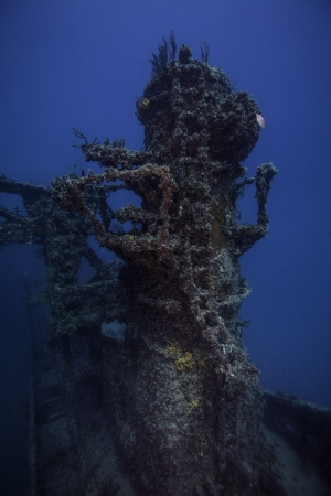 ship wreck: A crane tower on the Spiegel Grove in Key Largo, Florida. With a blue water Background Stock Photo