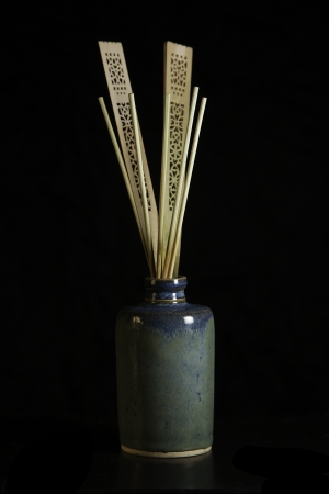 air diffuser: Oil diffuser with bamboo reeds isolated on black Stock Photo