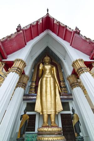 Buddha Status and Pagoda at Wat dhammamongkol Stock Photo