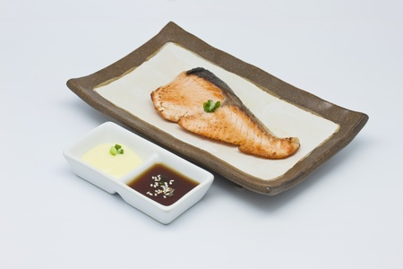 Salmon fish grilled in the plate on white background photo