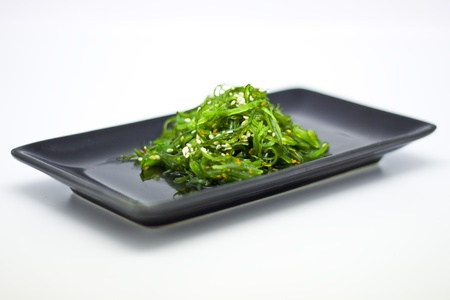 algaes: Bowls of Healthy Seaweed Salad in black plate with sauce Stock Photo