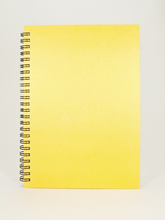 Yellow color Cover Note Book Stock Photo