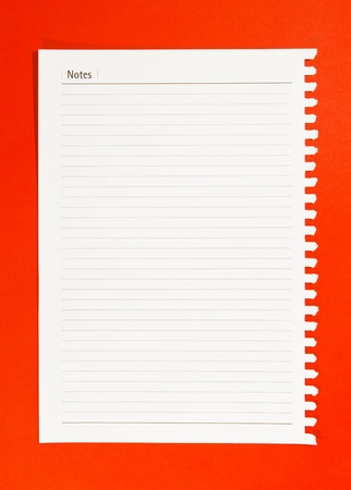 notebook paper on red background  Stock Photo - 11067928