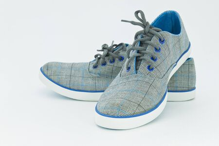 Blue sneakers over the white background  photo