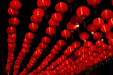 Big red lanterns will bring good luck and peace to prayer. It was at night in a chinese temple during Chinese New Year.  Editorial