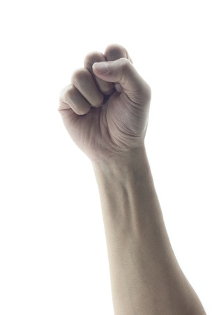 closed fist sign: clenched fist hand closeup white background conceptual studio