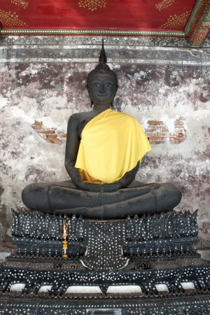 godliness: Buddhas statue at the temple of Wat Suthat Thepphawararam in Bangkok, Thailand
