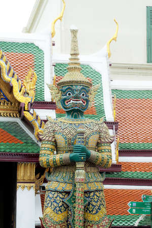 Stone guardian of Wat Phra Kaew temple next to the Bangkok Grand Palace  photo