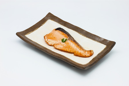 Salmon fish grilled in the plate on white background Stock Photo