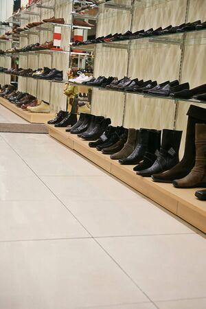shelfs: Samples of footwear on shelfs in shop Stock Photo