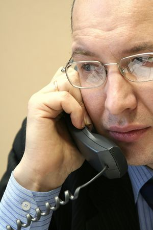 Young the man in glasses speaks by phone at office Stock Photo - 2213778