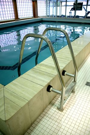 Fragment of swimming-pool with a ladder  photo