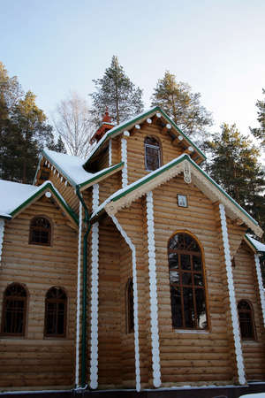 The wooden house in a winter wood Stock Photo - 2246086