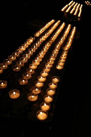 Set of burning candles in a cathedral photo