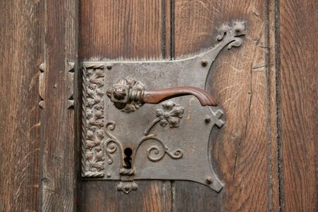 door knob: The old metal handle of a door