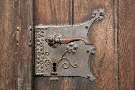 The old metal handle of a door