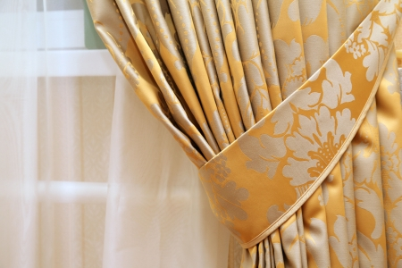 window curtains: beautiful curtain on edge of a window Stock Photo