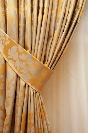 beautiful curtain on edge of a window photo