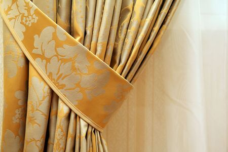 drapes: beautiful curtain on edge of a window Stock Photo