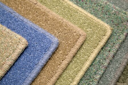 Samples of carpet coverings in shop photo