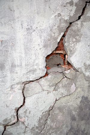 cracked cement: Crack on a wall of an old building Stock Photo