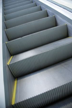 without people: Steps of the moving escalator without people