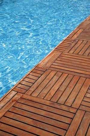 Fragment of a swimming pool and wooden floor Stock Photo
