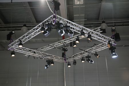 Projectors on a stage under a ceiling photo