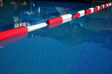 Rope with plastic anchor buoys in a swimming pool Stock Photo - 3595704