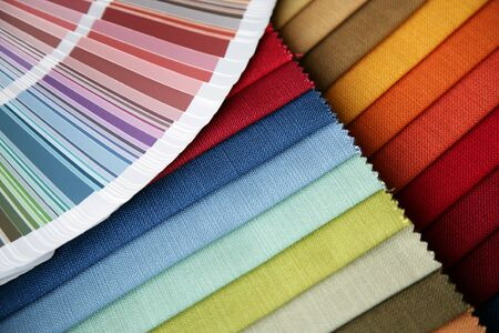 samples of a fabric and opened color card with various colors photo