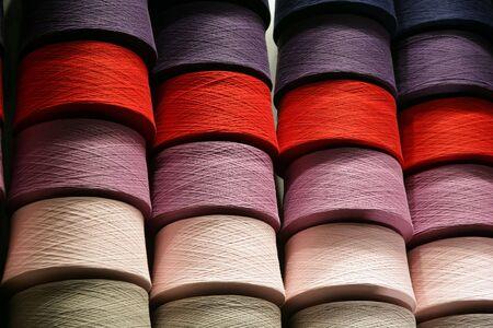 Bobbins with the coloured threads on storage Zdjęcie Seryjne
