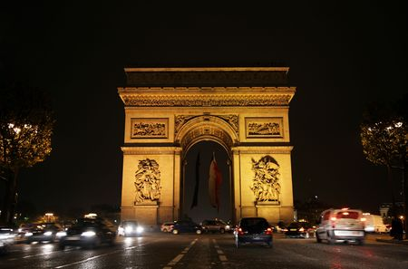 A triumphal arch is in the nightly light, Paris photo