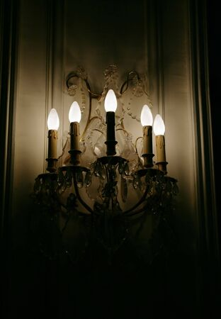 gleams: The wall fixture in the old house