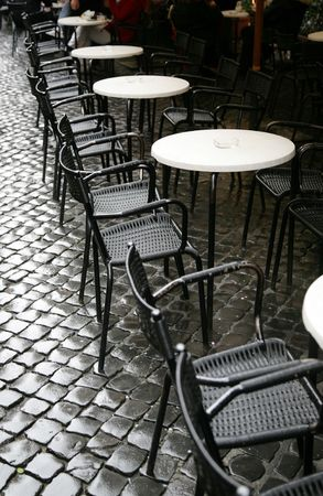 Tables of restaurant on a city sidewalk photo