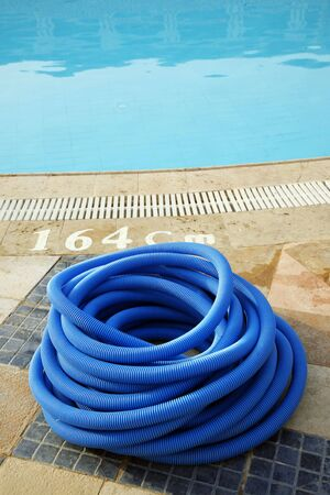 Dark blue plastic hose for cleaning of pool photo