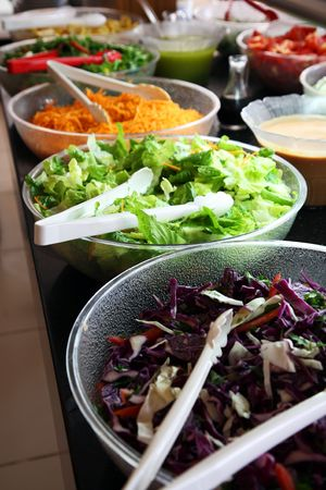 Counter with the vegetables prepared for salads